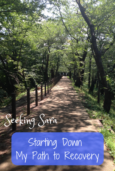 "A photograph of a sunny path in the woods with shadows from the trees stretching across it. Text reads ""Starting Down My Path to Recovery. Seeking Sara."""